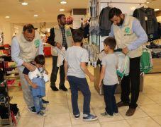 Umut Kervanı'ndan yetim çocuklara giyim yardımı